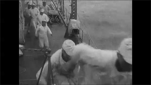 1940s Guadalcanal: Needle points at gauge.  Man works.  Machine.  Ship in water.  Man waves flags.  Sailors run up steps.  Man closes porthole.  Map appears.