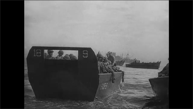 1940s Guadalcanal: Beach.  Soldiers climb onto boat.  Men wave.