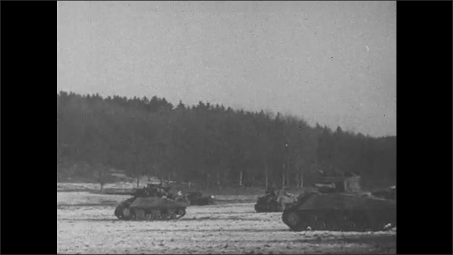 1940s: tanks driving through snow-covered field, German soldiers surrendering with hands up