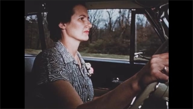 1950s: Road in country. Woman drives car. Car pulls up to schoolhouse.