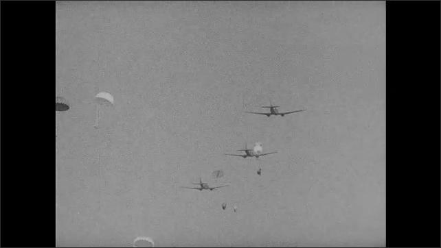 1940s: Officers salute and shake airman's hand. Words appear over cargo plane in flight. Airmen parachute from planes. Man lands in field with parachute. Man drops from parachute hung in tree.
