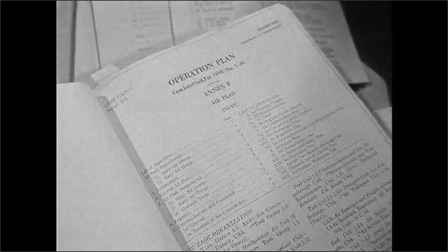 1940s: Close up shots of documents on table.