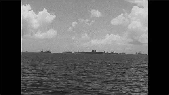 1940s: Ships on ocean.  Clouds.