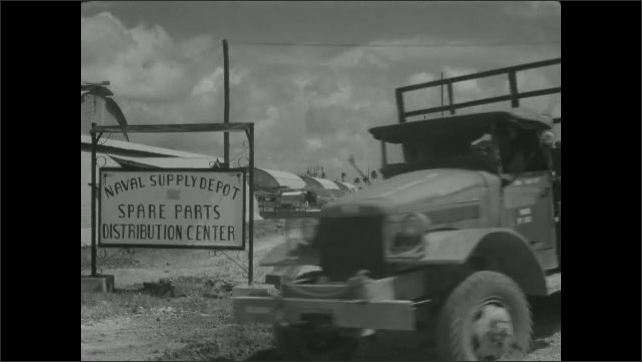 1940s: Naval Supply Depot. Truck drives by.