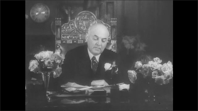 1930s San Francisco: Crowded food market, customers wait at counter, men wrap food. People rush from building carrying food parcels. Mayor Rossi sits at desk with flower arrangements, makes address.