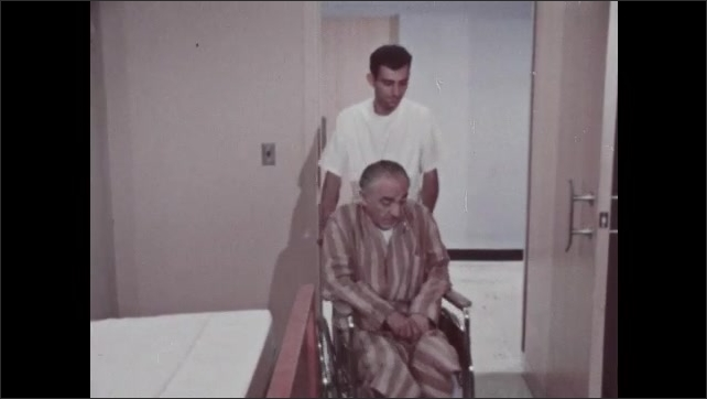 1960s: Nurse wheels patient into elevator. Nurse wheels patient next to bed in hospital room.