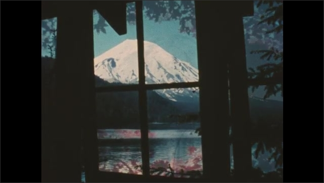 """1980s Washington: Men speak near sign.  Man fishes.  Lamps on table.  Mount St. Helens.  Caption reads """"THIS PLACE IN TIME.  The Mount St. Helens Story.""""  Tall grasses wave in wind."""