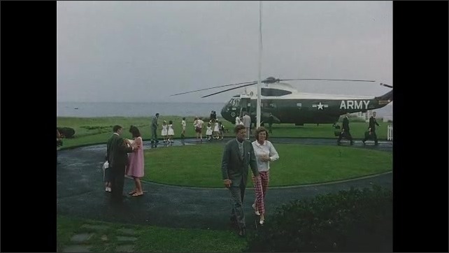 1960s: John F Kennedy kisses Jacqueline Kennedy, children by helicopter in background. Kennedy walking with sister Eunice. Jacqueline Kennedy greets Robert and Ethel Kennedy with kids.