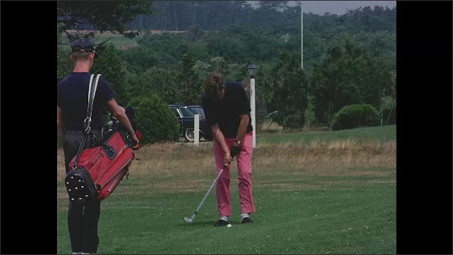 1960s: Slow motion, John F Kennedy hitting golf ball.