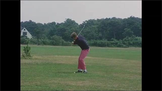 1960s: Slow motion, John F Kennedy hits golf ball, caddie walks past camera.