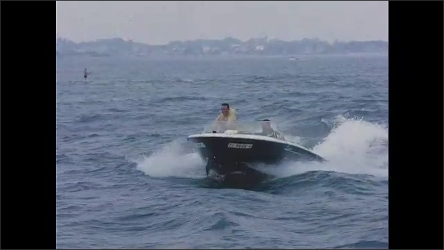 1960s: Close up of Jacqueline Kennedy reading. Men driving speed boat.