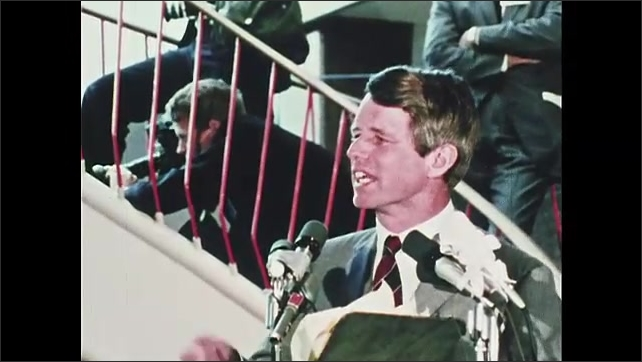 1960s Oregon: Robert F. Kennedy stands at podium, speaks. Crowd claps and cheers.