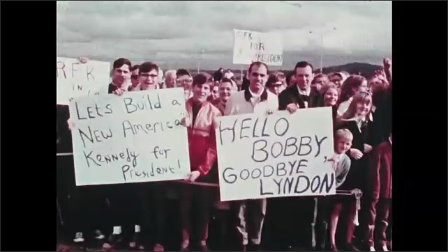 1960s Oregon: Robert F. Kennedy shakes hands and waves to crowd.  Shopping mall.  Gym.  People hold signs.