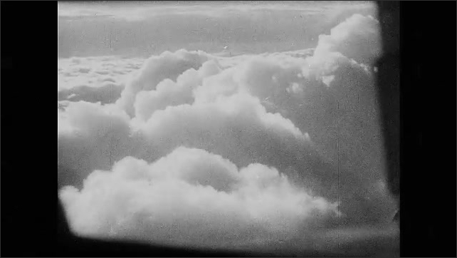 1930s Germany: plane flying over the top of clouds