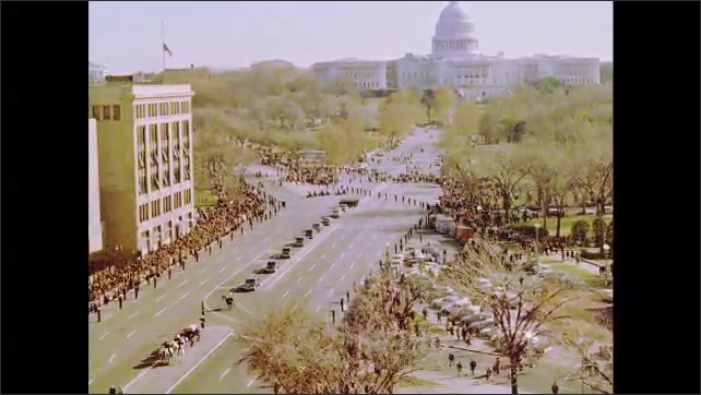 1960s: Soldiers march in front of the horse drawn casket on Pennsylvania avenue as part of Kennedy's funeral procession.