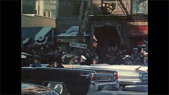 1960s: Cars carrying inauguaration dignitaries drive by, with passengers waving. Crowd waves and cheers. Car drives Eleanor Roosevelt, Ethel Wilson and General Thomas D. White drive on parade route.