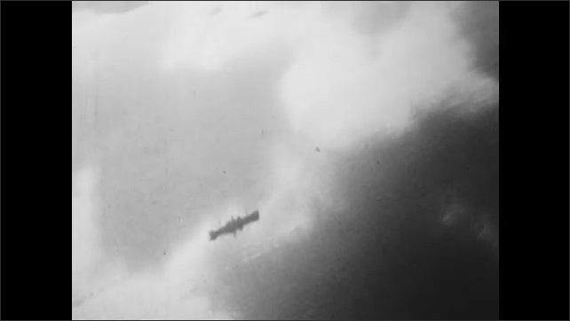 1940s: UNITED STATES: weapons firing in air raid. View of clouds and land from plane. Plane flies over atoll.