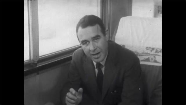 1960s: Man sits on train, talks.