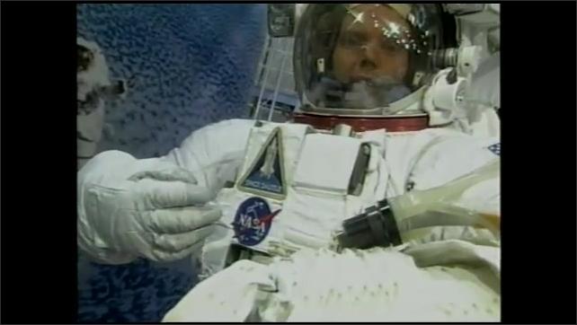 2000s: Man in space suit talks.