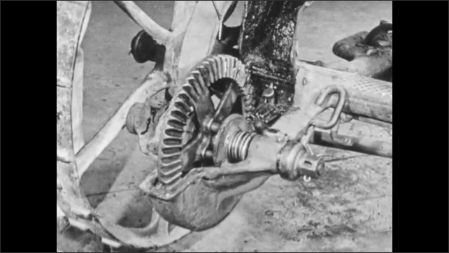 1950s: Hand drops oil onto gears of mower.