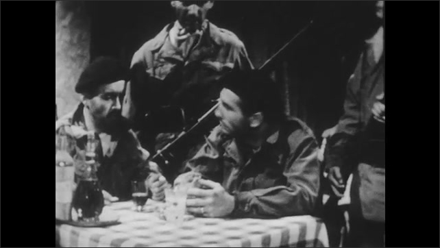 1950s: Soldiers sit at table in restaurant.  Men appear behind them.  Men speak.  Man is forced to his feet and dragged away.