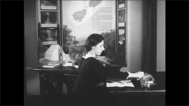 1930s: Mailman puts letters on desk. Woman opens letters, reads them and stamps them.
