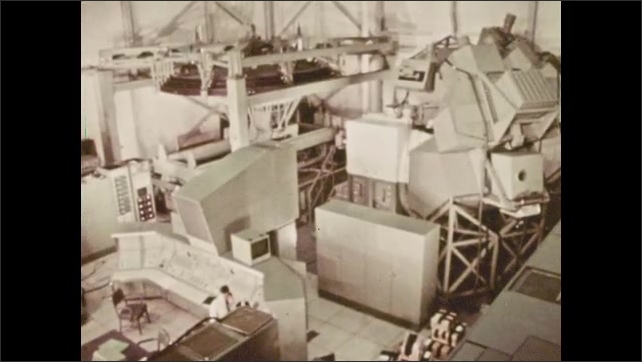 1970s: simulation of the lunar landing on the moon's surface, the lunar lander module in the training center, a different flight simulator taking off outside
