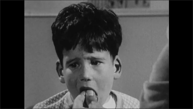 1960s: Man feeds boy candy when he says his name correctly.