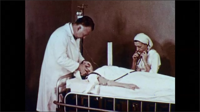 1950s: Man holds x-ray and speaks.  Doctor and nurse examine patient.  Doctor holds and releases woman's head.