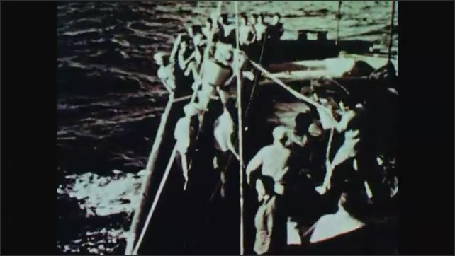 1960s: Men on boat use pulleys to pull cone of rocket out of ocean and onto boat. Rocket launches into sky.