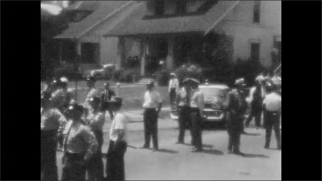 1950s: Protest march.  Police wait in road.