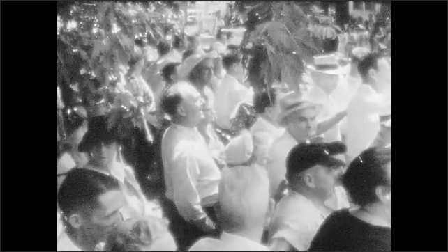 1950s: Protesters.  Man yells.