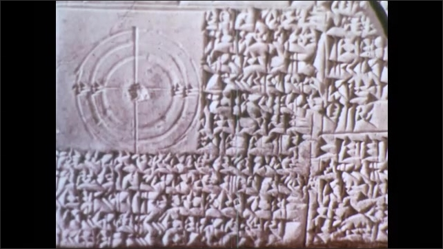 1950s: Hand holds Sumerian clay tablets, cuneiform writing, numbers, circle divided into 360 degrees, angles.