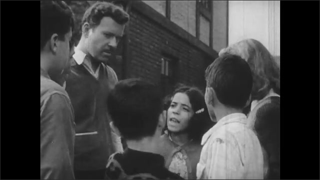 1940s: Children run and hide from man hiding head against lamp post. Boy crouched behind wall throws object. Children argue while man listens. Boy talks.