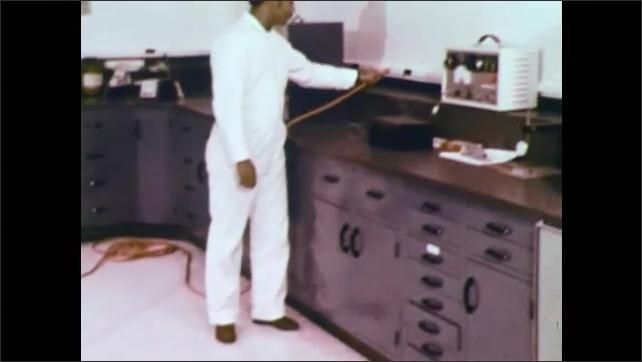 1970s: UNITED STATES: machine polishes floor. Rotary single disc machine. Incorrect positioning of machine.