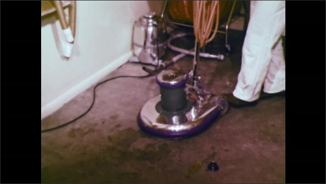 1970s: UNITED STATES: man wipes electrical cord and machine in cleaning cupboard. Man tightens screws on machine. Man lubricates machine with oil.