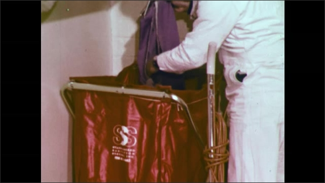 1970s: UNITED STATES: man empties dust bag on vacuum. Man removes dust from head of machine. Impacted dirt in machine. Man empties dust from bag.