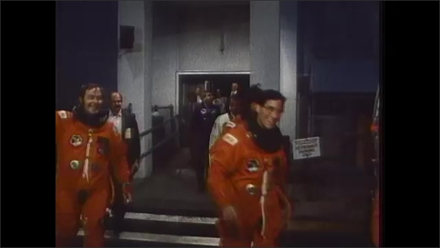 1980s: UNITED STATES: April 5th shuttle launch. Astronauts walk to vehicle.