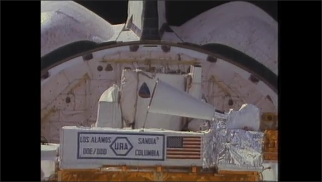 1980s: UNITED STATES: astronaut collects scientific data. Infrared telescope. URA telescope.