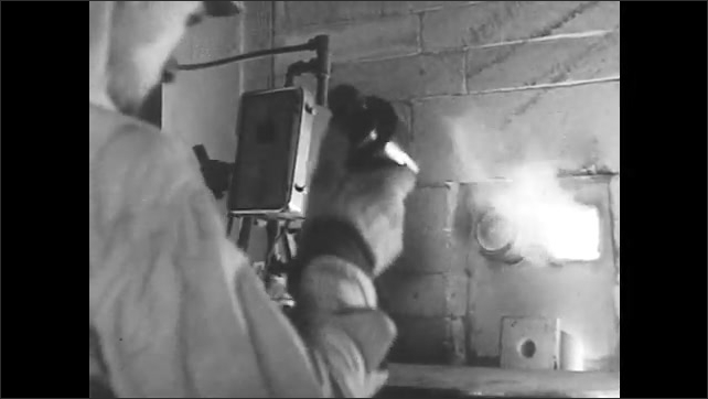 """1930s: Words: """"another view of melting."""" Furnace and sand. Words explain temps checked with special equipment. Words explain batch is sampled. Man opens fiery hole."""