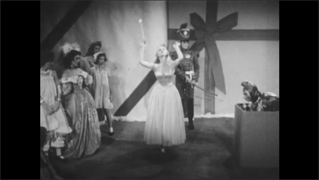 1950s: Fairy Snow Queen draws the toys towards the Jack in the Box. Fairy Snow Queen gestures towards the Jack in the Box.