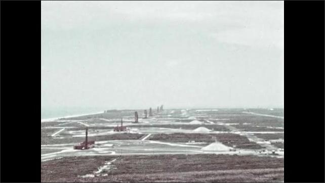 1960s: Footage of real launch pad and facilities. NASA logo and rocket tower.