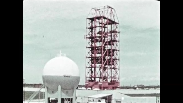 1960s: Liquid oxygen spherical tank at facility. Control tower view.