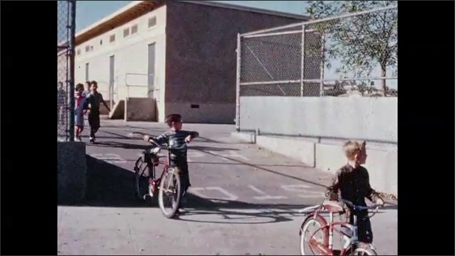 1960s: boys play tetherball in playground. girls with textbooks get into station wagon. students ride bikes and walk away from school. boy and girl stop at crosswalk and look both ways.