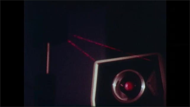 1980s: Man in lab, laser beam shines on machine. Machine emits laser beams, hand adjusts machine, laser color changes. Lasers shown on split screens.