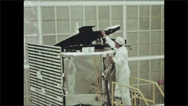 1960s: man stands on top of stair ladder, opens up panels and inspects orbiting astronomical observatory. guy stares at wave in oscilloscope. finger presses red button. rocket launches from pad.