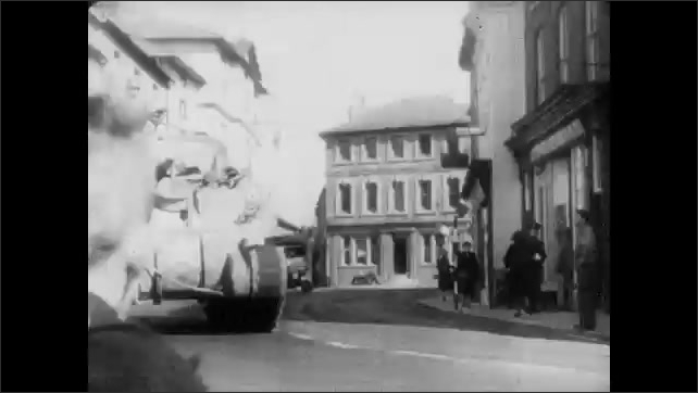 1940s: Eisenhower and British generals point to a map on a wall. Tanks roll through the streets of Southern England. A caravan of military trucks on the road. A truck drags a line of airplanes.