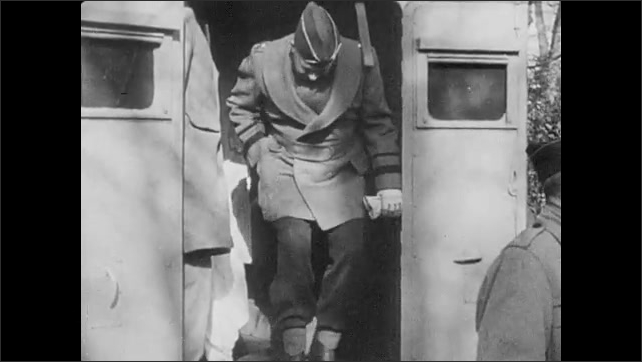 1940s: Bored allied soldiers on warships. They play cards, lay around. Eisenhower exits the back of a van with Bernard Montgomery.