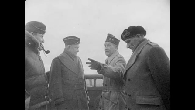 1940s: Eisenhower walks with Bernard Montgomery, talks to other officers. Rain clouds move across the sky. Rain droplets on the ground.
