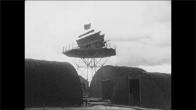 1940s: US Army truck drives through mud. Man on ship hold spinning weather vane. Spinning weather station. Men draw on large pane of glass with a grid.